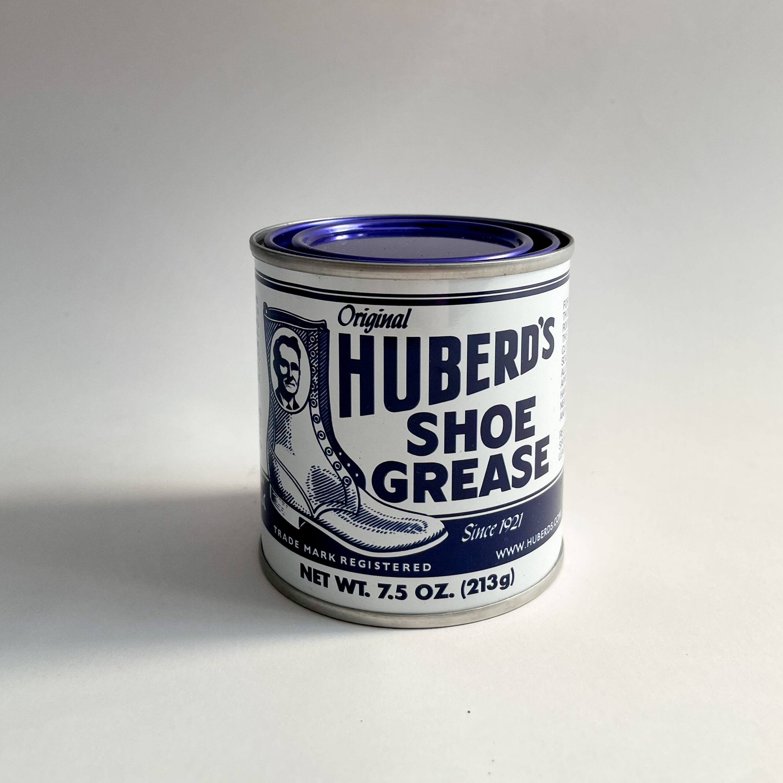 The front of a can of Huberd's Shoe Grease