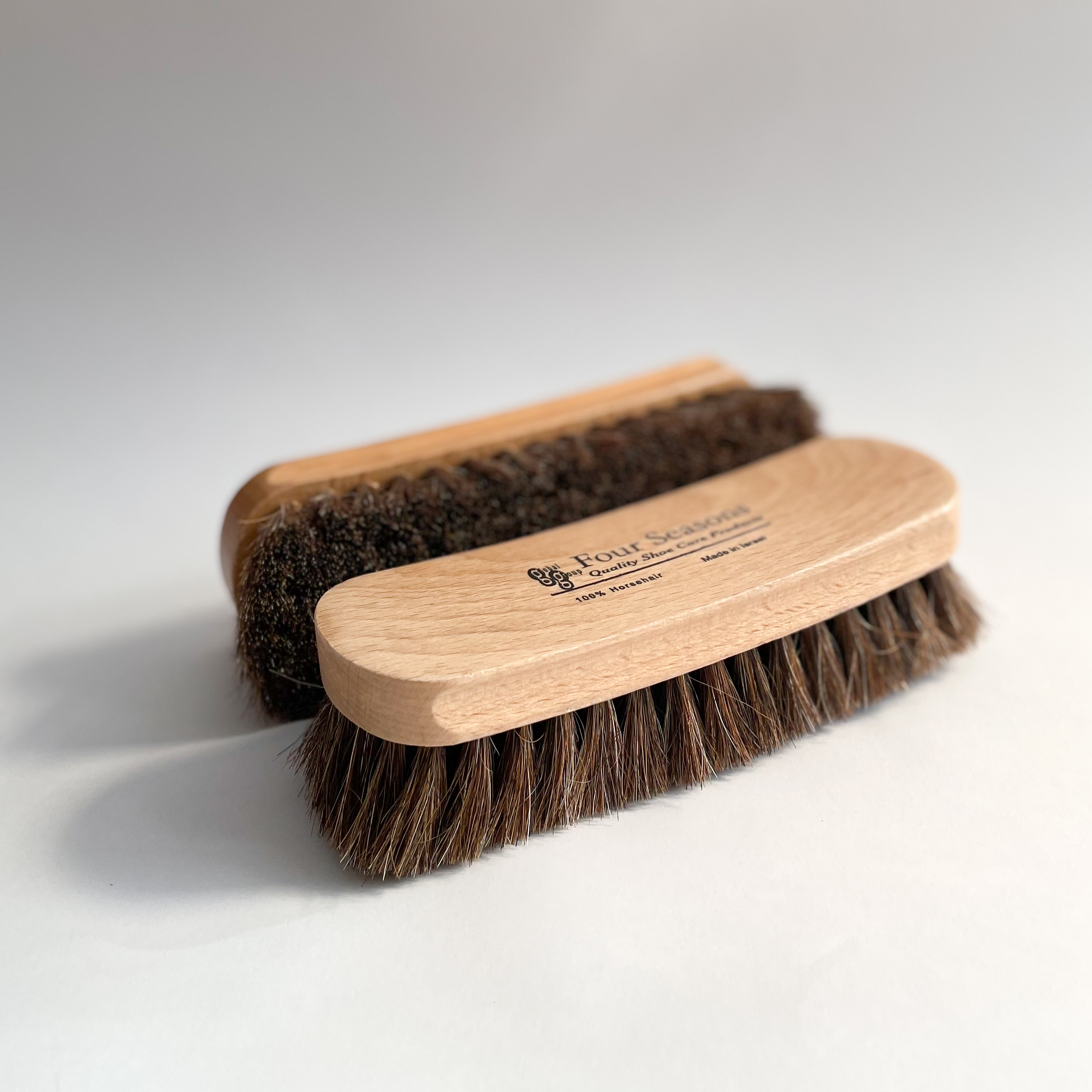 Two large buffing brushes, side by side
