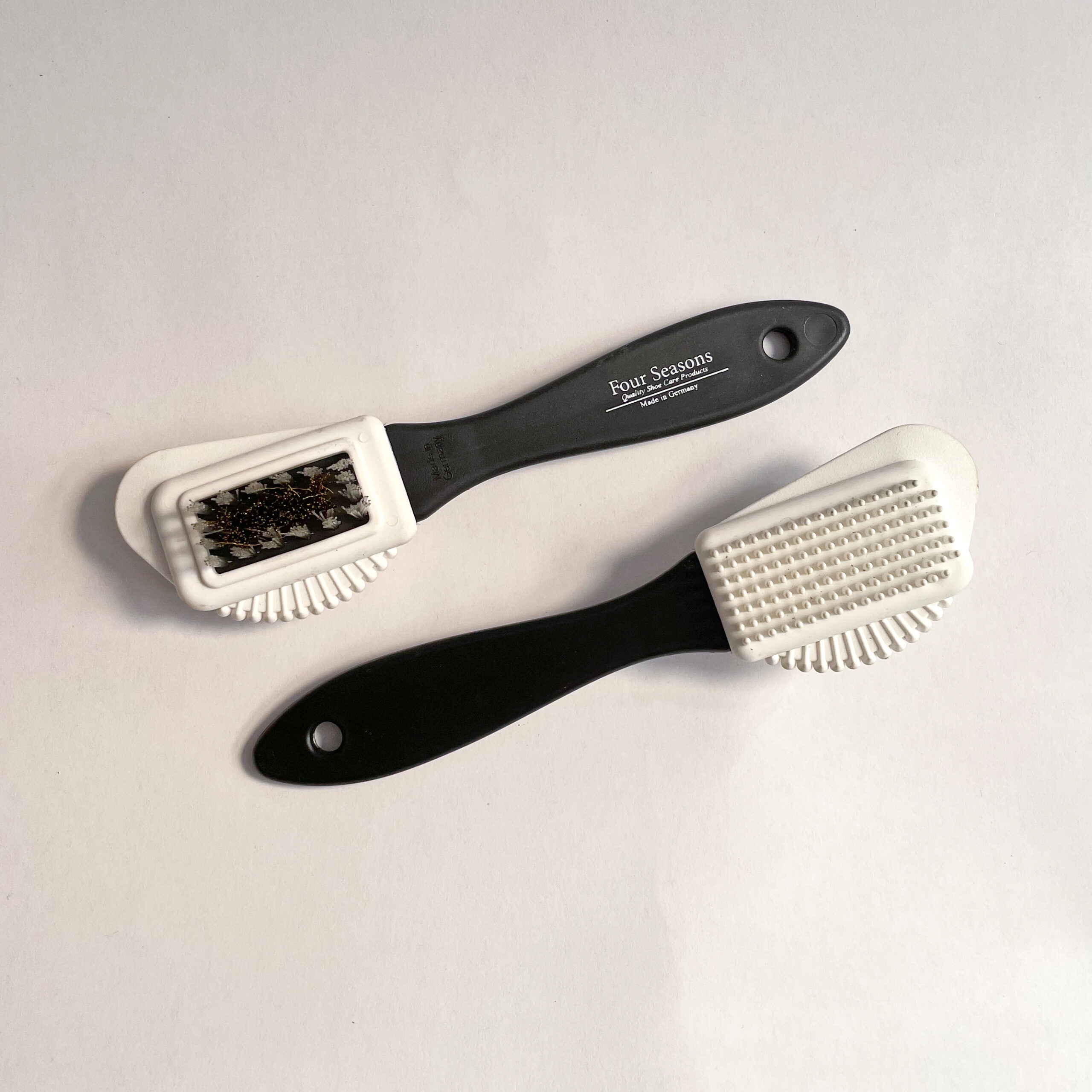 Two Suede Combi brushes laying side by side and diagonal angle