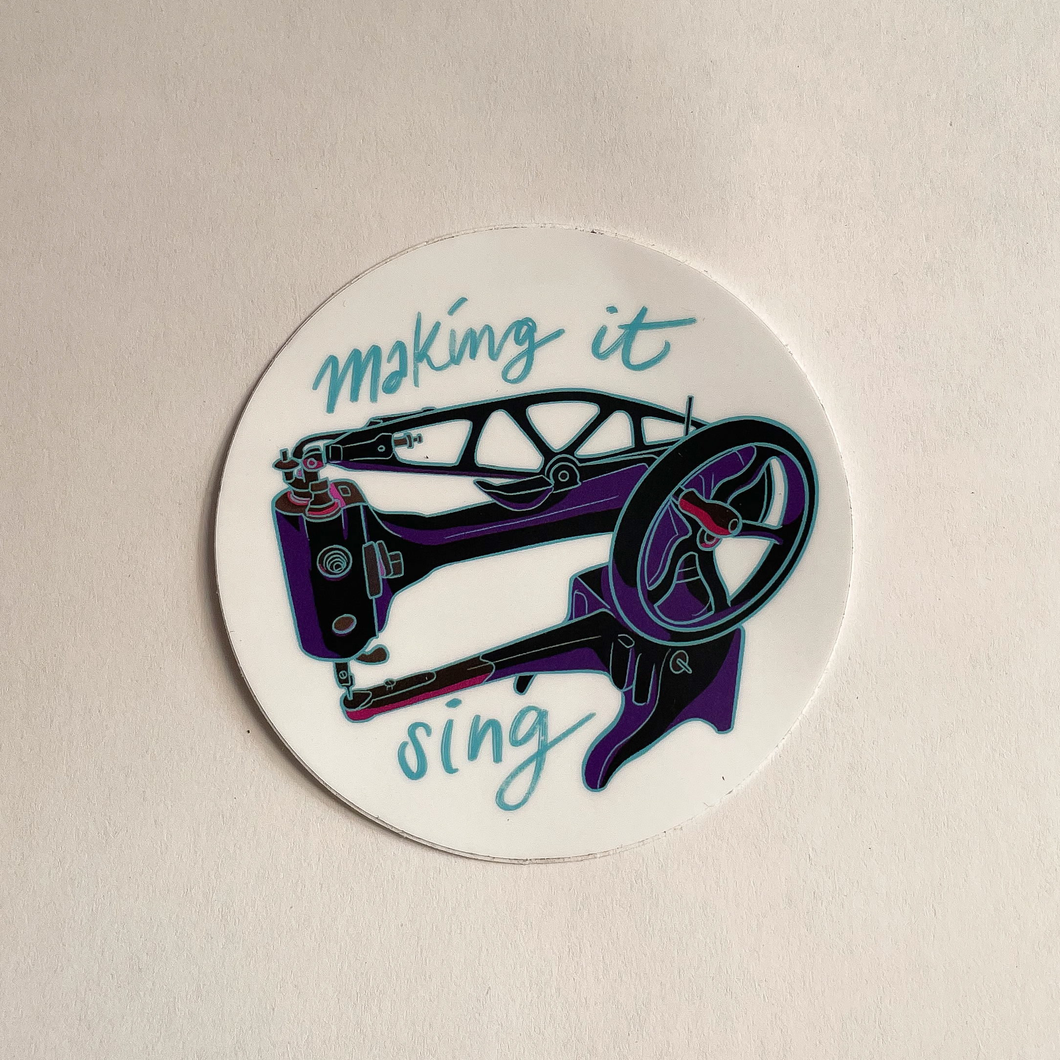 """Sticker of a Singer 29k Sewing machine surrounded by """"Making it Sing"""""""
