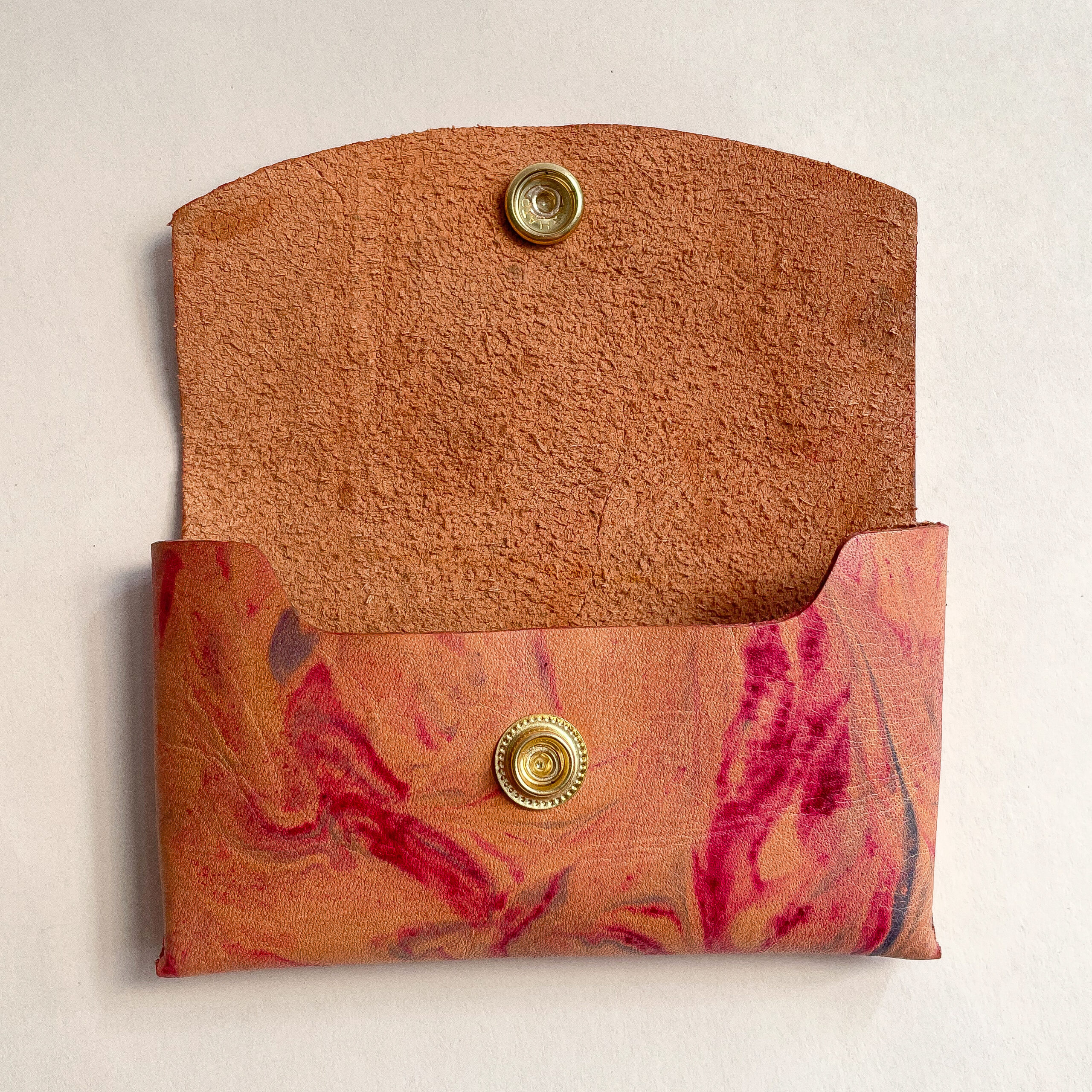 The Marbled Leather Card Case open with the inside visible