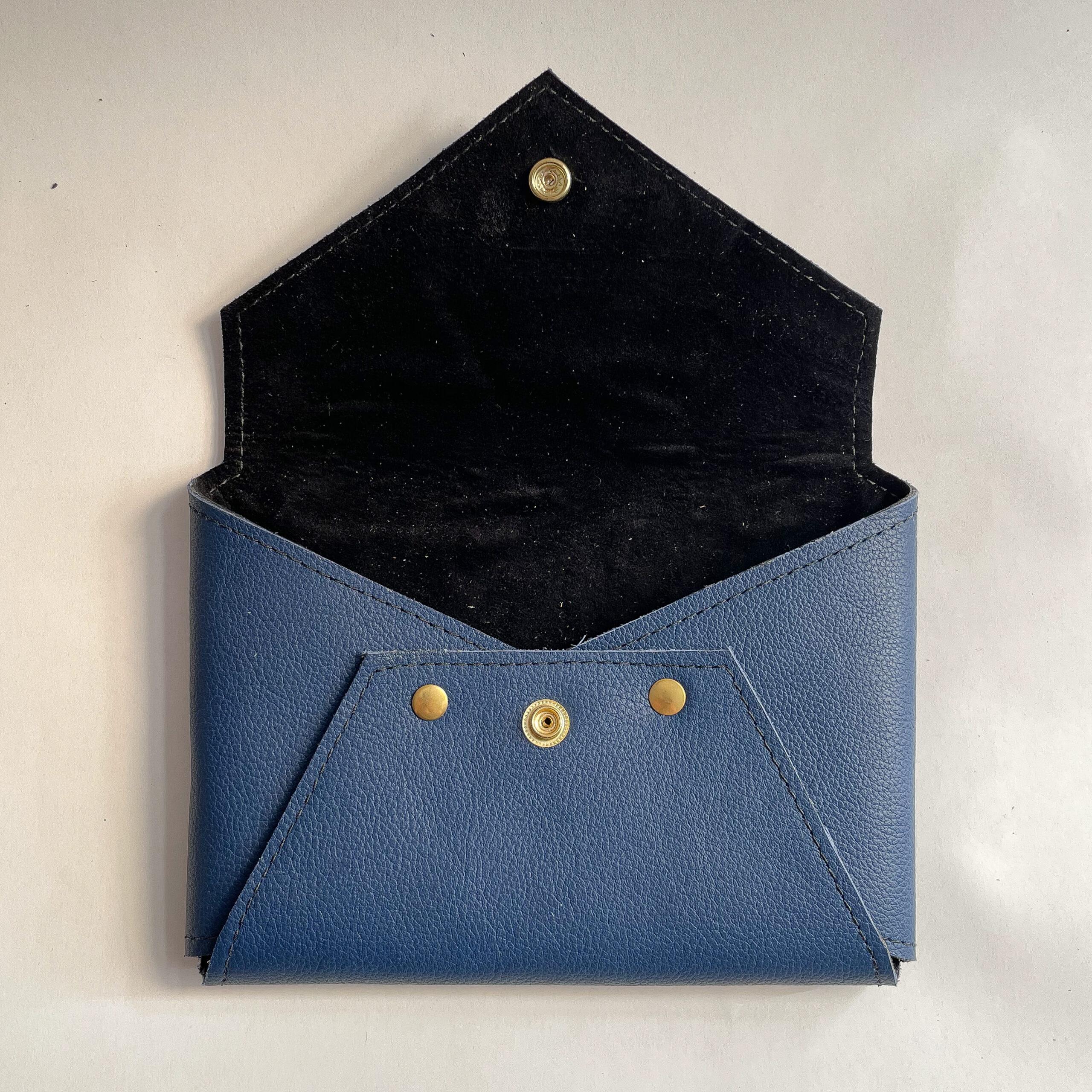 Open blue Envelope Clutch showing black lining