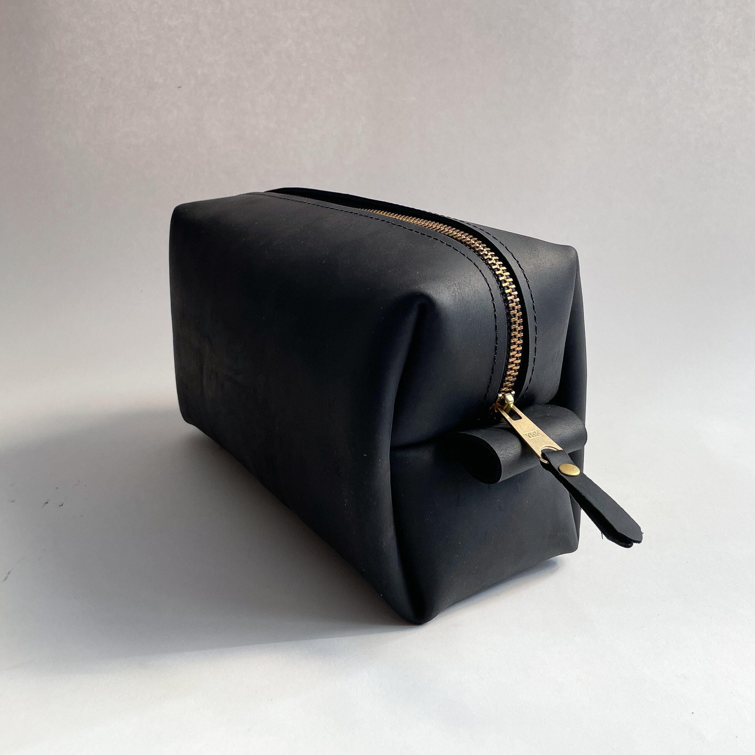 A black leather dopp kit